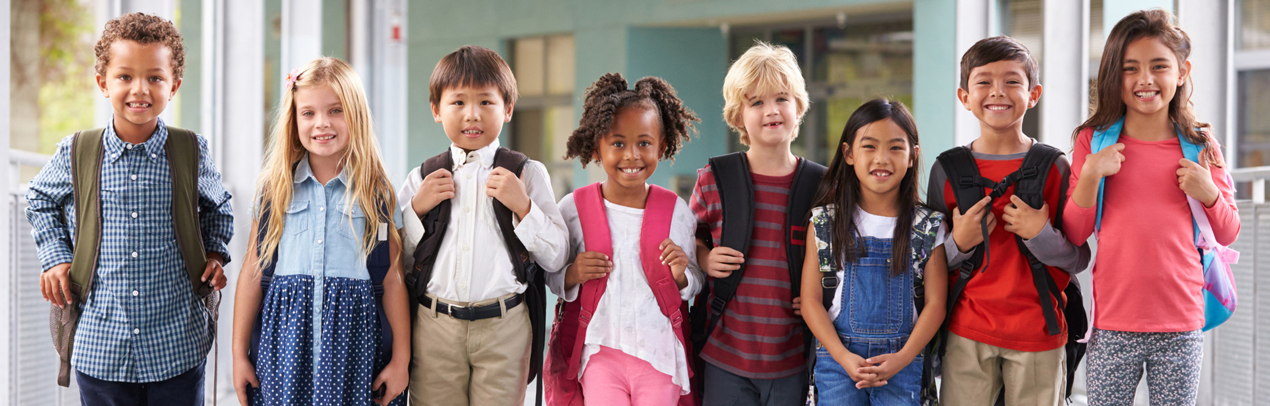 Students Standing in Line with Backpacks