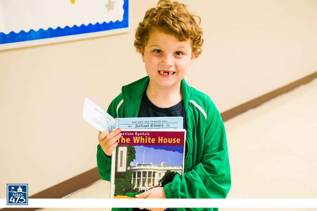 Picture of a student with a book about the White House